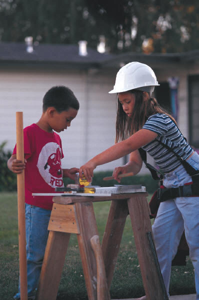 Two children building